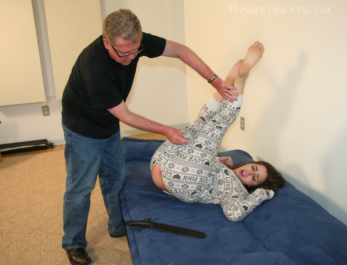 When Adriana refused to roll onto her belly for her punishment, her father  folds her backwards and she is strapped in the humiliating diaper position.